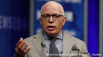 Michael Wolff gestures during a TV interview.