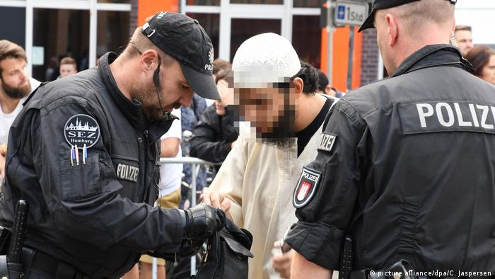 Demonstrating salafist in Germany being checked by police