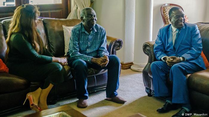Zimbabwe's new president, Emmerson Mnangagwa is sitting on a sofa near Morgan Tsvangirai
