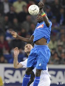 Hoffenheim's Demba Ba, right, challenges for the ball with Berlin's Josip Simunic during the German first division Bundesliga soccer match between TSG 1899 Hoffenheim and Hertha BCS Berlin in Sinsheim, Germany, on Friday, April 24, 2009. (AP Photo/Daniel Maurer) ** NO MOBILE USE UNTIL 2 HOURS AFTER THE MATCH, WEBSITE USERS ARE OBLIGED TO COMPLY WITH DFL-RESTRICTIONS, SEE INSTRUCTIONS FOR DETAILS **