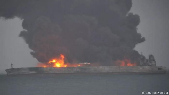 Black smoke billows from a tanker on fire in the East China Sea