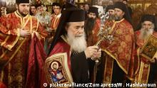 January 6, 2018 - Bethlehem, West Bank, Palestinian Territory - Jerusalem's Greek Orthodox patriarch Theophilos III attends a Christmas service according to the Eastern Orthodox calendar, in the church of Nativity in the West Bank town of Bethlehem on January 6, 2018. The municipalities of Bethlehem, Beit Sahour and Beit Jala, all in the Israeli-occupied West Bank, called for the boycott over Jerusalem's Greek Orthodox patriarch allegedly allowing controversial real estate sales  