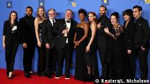 7.1.2018*** 75thGolden Globe Awards – Photo Room – Beverly Hills, California, U.S.,07/01/2018– The cast and producers of The Handmaid's Tale pose with the awards they won for Best Television Series - Drama. REUTERS/Lucy Nicholson
