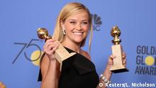 7.1.2018*** 75thGolden Globe Awards – Photo Room – Beverly Hills, California, U.S.,07/01/2018– Reese Witherspoon holds the award she won for Best Television Limited Series or Motion Picture Made for Television for Big Little Lies. REUTERS/Lucy Nicholson