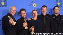 Martin McDonagh, Sam Rockwell, Frances McDormand, Graham Broadbent and Peter Czernin pose with the award for Best Motion Picture Drama for 'Three Billboards Outside Ebbing, Missouri' during the 75th Golden Globe Awards on January 7, 2018, in Beverly Hills, California. / AFP PHOTO / Frederic J. BROWN (Photo credit should read FREDERIC J. BROWN/AFP/Getty Images)