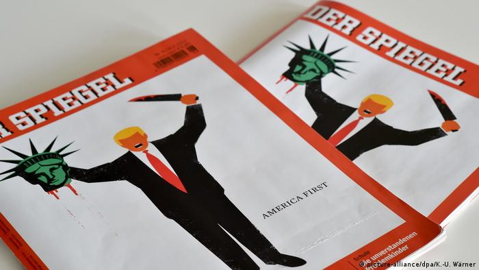 Cartoon of Trump beheading Statue of Liberty, Der Spiegel America First cover, Nr. 6 /2017 (picture-alliance/dpa/K.-U. Wärner)