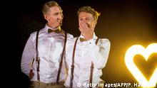 08.01.2018 Australian Commonwealth Games sprinter Craig Burns (L) and fiance Luke Sullivan (R) pose ahead of their marriage ceremony at Summergrove Estate, New South Wales on January 8, 2018. Australia officially become the 26th country to legalise same-sex marriage after the law was passed on December 9, 2017, with the overwhelming backing of the Federal Parliament. / AFP PHOTO / Patrick HAMILTON / IMAGE RESTRICTED TO EDITORIAL USE - STRICTLY NO COMMERCIAL USE (Photo credit should read PATRICK HAMILTON/AFP/Getty Images)