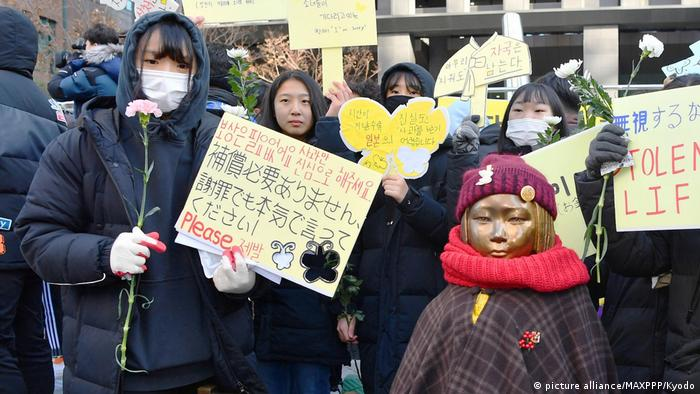 People protest in front of Japan's embassy in Seoul