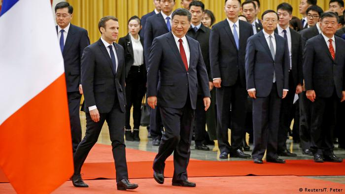 French President Emmanuel Macron and Chinese President Xi Jinping attend a welcoming ceremony at the Great Hall of the People in Beijing, China January 9, 2018.