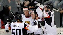 Germany's players, from left, Patrick Hager, Christoph Schubert, Kai Hospel, Sven Butenschon, celebrate their second goal in the Group B Preliminary Round game between Switzerland and Germany at the IIHF 2009 World Championship at the Postfinance-Arena in Berne, Switzerland, on Sunday, April 26, 2009. (AP Photo/KEYSTONE/Salvatore Di Nolfi)