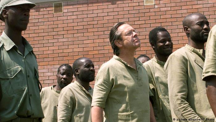 A group of alleged mercenaries being escorted to a court hearing in Zimbabwe