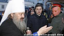 January 8, 2018 - Kiev, Ukraine - A priest of Ukrainian Orthodox Church (Moscow Patriarchy) (L) argues with activist during their protest near of Kiev-Pechersk Lavra entrance in Kiev, Ukraine, 08 January 2018. Pro-Ukrainian activists protest against of priests of Orthodox Church of Moscow Patriarchate who supports separatism on the East of Ukraine as they told. The protest had provoked a case when a Moscow-led church refused to bury the one-year-old boy who was crushed by a drunk man who jumped out of an eight-story apartment in Ukraine's Zaporizhia city because he was christened by a rival one that is overseen by Kyiv as local media report. The Ukrainian Church has been split on the Moscow's and Kiev's patriarchates since the Soviet Union's collapse in 1991 and hostility has been heightened by the Russian-fueled war in eastern Ukraine that has killed more than 10,000 people in nearly four years  
