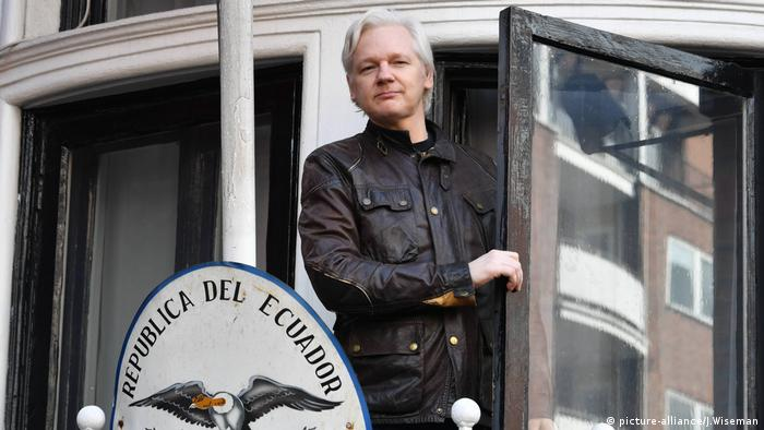 Assange appears at the balcony of the Ecuadorian Embassy in London in 2017