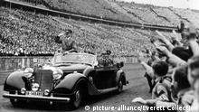 BERLIN--Adolph Hitler (in auto) salutes the huge, cherring crowd in Olympic Stadium upon his arrival to address a May Day youth parade. 5/8/39.   Keine Weitergabe an Wiederverkäufer.