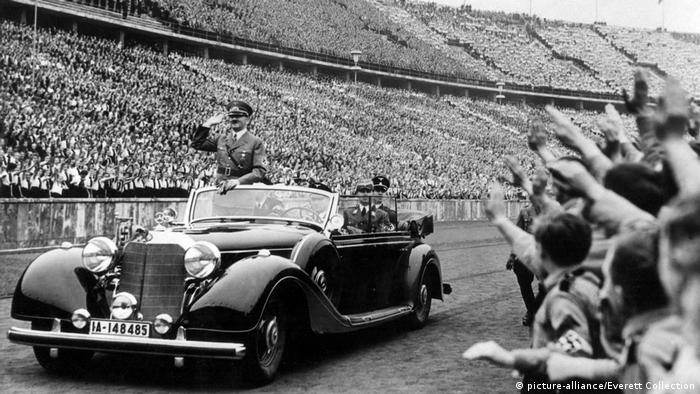 Adolph Hitler driving past cheering crowds in Berlin's Olympic Stadium in 1939
