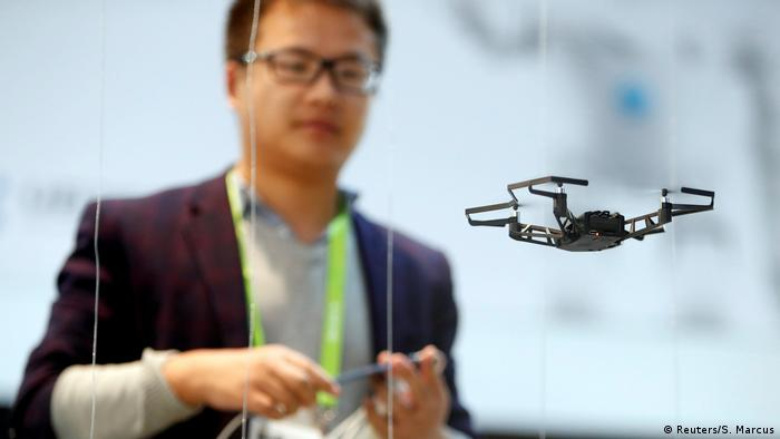 A man operates a drone using his mobile phone at CES 2018. (Reuters/S. Marcus)