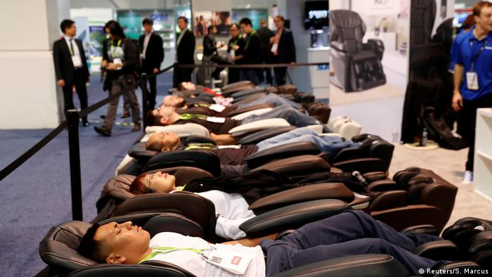 Attendees try out the Panasonic MAJ7 massage chair during the 2018 CES (Reuters/S. Marcus)