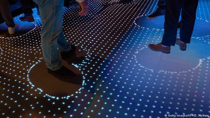 People walk through the Watson Premier display to learn about IBM Watson at CES 2018 (Getty Images/AFP/D. McNew)