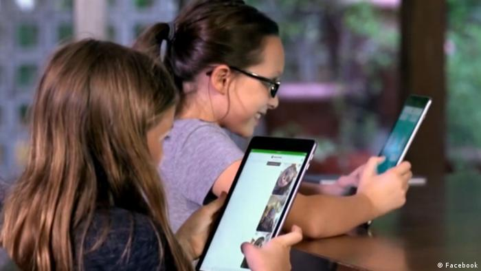 Kids look at Facebook on tablets