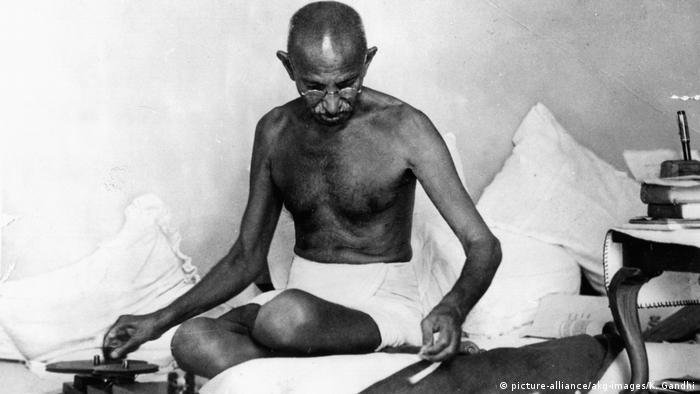 Gandhi sitting and writing