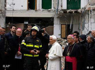 The Pope in a yard with rescue workers