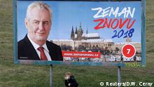 A woman walks past a presidential election campaign poster of incumbent Milos Zeman in Prague, Czech Republic January 11, 2018. The poster reads: Zeman again 2018. REUTERS/David W Cerny NO RESALES. NO ARCHIVES