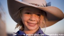 This photo taken in 2009 and provided by Akubra Hats, shows Amy Dolly Everett in Brunette Downs in the Northern Territory, Australia. Hundreds of people are remembering Dolly who was known as the angelic face of the Australian bushmen's hat brand and whose family says she killed herself after being targeted by cyberbullying. A memorial service for Dolly was held in the tiny Northern Territory town of Katherine on Friday, Jan. 12, 2018 near her family's cattle ranch. (Akubra Hats via AP) |