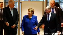 12.01.2017****Acting German Chancellor Angela Merkel, leader of the Christian Social Union in Bavaria (CSU) Horst Seehofer and Social Democratic Party (SPD) leader Martin Schulz arrive for a press conference after exploratory talks about forming a new coalition government at the SPD headquarters in Berlin, Germany, January 12, 2018. REUTERS/Fabrizio Bensch