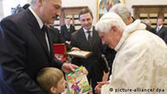 Pope Benedict XVI poses for a photgraph with Belarus President Alexander Lukashenko and his son Nikolai during their meeting at the Vatican, April 27, 2009