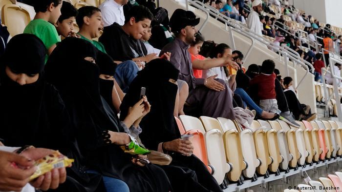 Saudi women watch the soccer match between Al-Ahli against Al-Batin at the King Abdullah Sports City