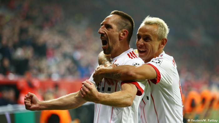Bayer Munich's Franck Ribery celebrates his second goal while embraced by Rafinha (Reuters/W. Rattay)