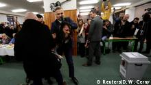 A Femen activist is clashing with Czech President Milos Zeman's bodyguards during the country's direct presidential election at a polling station in Prague, the Czech Republic January 12, 2018. REUTERS/David W Cerny