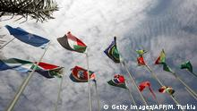 Flags representing some of the 30 different nations taking part in the 15th African Union Summit flutter at the entrance of the convention hall on the second day of the meeting in Kampala, Uganda on July 26, 2010. AFP PHOTO/MAHMUD TURKIA (Photo credit should read MAHMUD TURKIA/AFP/Getty Images)