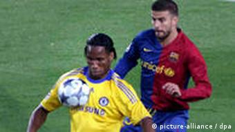 Barcelona defender Gerard Pique, right, fights for the ball with Chelsea striker Didier Drogba