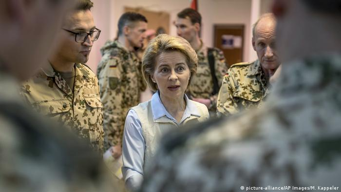 Ursula von der Leyen speaks with soldiers
