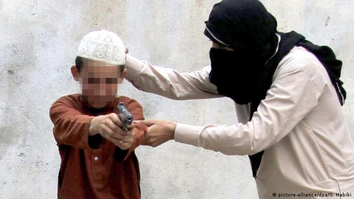 IS member training child with gun