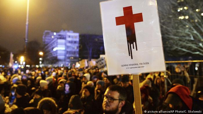 People protest against the tightening of abortion laws, near the Sejm in Warsaw AP Photo/Czarek Sokolowski