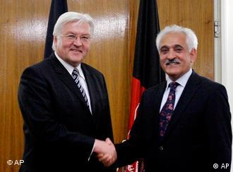 German Foreign Minister Frank-Walter Steinmeier, left, shakes hands with Afghan counterpart Rangin Dadfar Spanta during their meeting in Kabul Wednesday, April 29, 2009. Steinmeier arrived in the Afghan capital Wednesday morning on an unannounced two-day visit to meet with senior Afghan leadership. (AP Photo/Rahmat Gul)