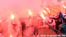 Tunisians carry flares and shout slogans against the government in Tunis, on January 14, 2018, during a demonstration over price hikes and austerity measures. / AFP PHOTO / Anis MILI (Photo credit should read ANIS MILI/AFP/Getty Images)