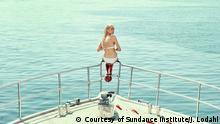 still from film Holiday, girl in the bow of a ship (Courtesy of Sundance Institute/J. Lodahl)