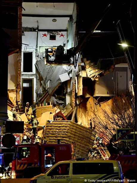 Firefighters inspect a collapsed building, at the Paardenmarkt in Antwerp (Getty Images/AFP/Belga/D. Waem)