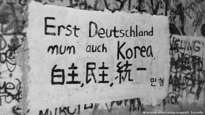 'First Germany, now Korea too, this Berlin Wall graffiti reads. Photo from November 9, 1989. (picture alliance/akg-images/G. Schaefer)