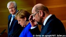 (LtoR) State Premier for the state of Bavaria and leader of the Christian Social Union (CSU), Horst Seehofer, German Chancellor Angela Merkel (CDU) and leader of the Social Democratic Party (SPD) Martin Schulz give a press conference after talks to form a new government on January 12, 2018 at the SPD headquarters in Berlin. German Chancellor Angela Merkel's conservatives reached a breakthrough deal with the country's second biggest party, the Social Democrats, toward building a new coalition government, sources close to the negotiations said. / AFP PHOTO / Tobias SCHWARZ (Photo credit should read TOBIAS SCHWARZ/AFP/Getty Images)