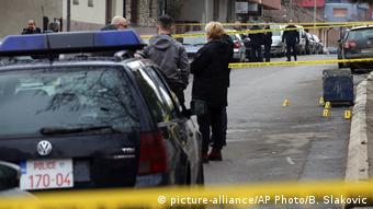 Police investigate the scene of murdered politician Oliver Ivanovic