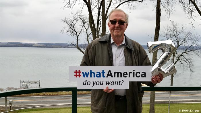 A Trump supporter holding a whatAmerica sign