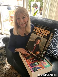 A Trump supporter holding a game