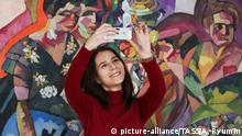 RYAZAN, RUSSIA - JANUARY 18, 2017: A girl takes a selfie by a painting at the Ryazan art museum she takes part in Museum Selfie Day, an initiative encouraging people to visit museums and enjoy art collections while picturing themselves in front of the exhibits. Alexander Ryumin/TASS  