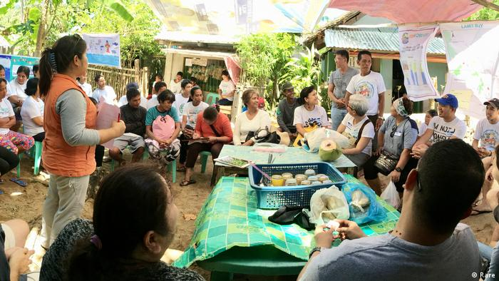 Photo: Rare experts meet with fishermen in the Philippines (Source: Rare)