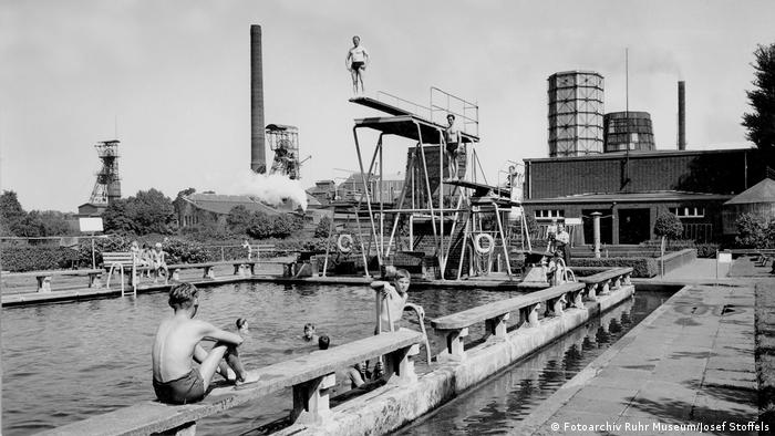 A photo of swimmers in the Zollverein mine complex. (Photo archive Ruhr Museum/Josef Stoffels)