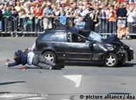 Bystanders are dragged along by the car
